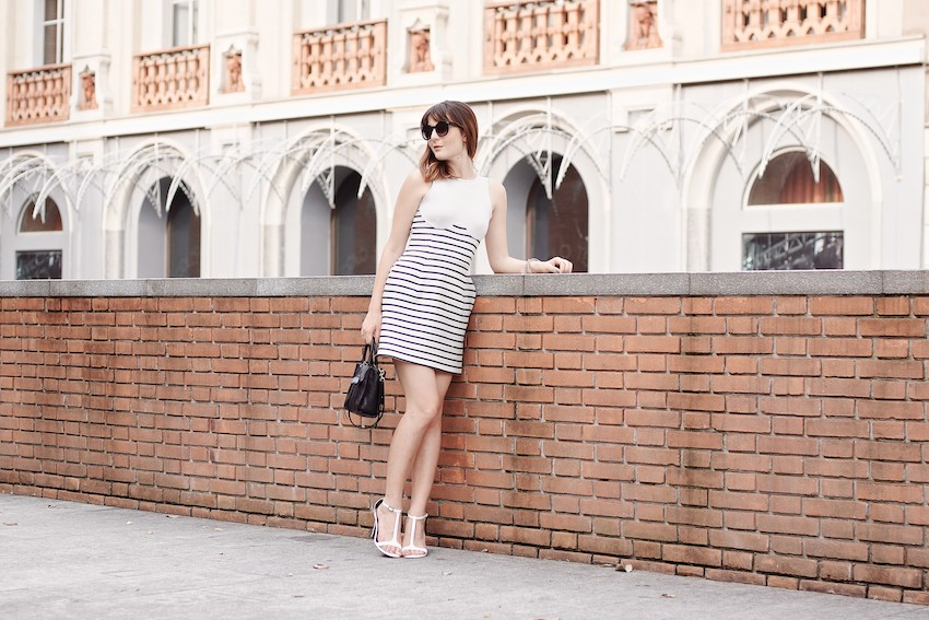 Chic cocktail look featuring a striped raffia dress , white sandals and black accessories. Irene Buffa in Milano