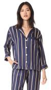 Tea Leoni in navy striped silk pajama on Madam Secretary season 4 ... 9be1f08b0