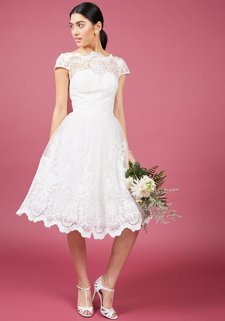 20 short wedding dresses gowns we love how short wedding dresses can create a totally different bridal look style elegance romance femininity and fun are not lost by showing off your ombrellifo Image collections