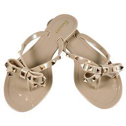 TENGYUFLY Womens Rivets Bowtie Flip Flops Jelly Thong Sandal Rubber Flat Summer Beach Rain Shoes   Amazon (US)
