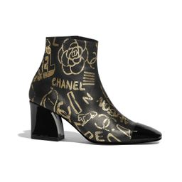Printed Lambskin & Patent Calfskin Gold & Black Ankle Boots | CHANEL | Chanel, Inc.