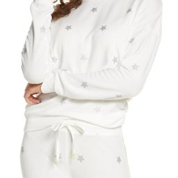 A cuddly soft pullover for long nights or lazy days is cut from peached jersey dotted with glitte... | Nordstrom