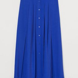 Calf-length skirt in woven viscose fabric with a high waist, pleats, buttons at front, and high s... | H&M (US)