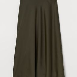 Calf-length skirt in softly draped woven fabric with a high waist. Concealed side zipper. Unlined... | H&M (US)