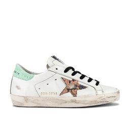 Golden Goose Superstar Sneaker in White & Orange Snake from Revolve.com | Revolve Clothing (Global)