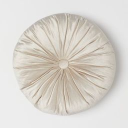Round cushion in velvet. Large, covered button at center and decorative pleats. Polyester fill.   H&M (US)