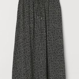 Calf-length skirt in woven viscose fabric. High waist and covered, elasticized waistband with dra...   H&M (US)