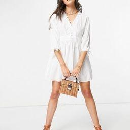 ASOS DESIGN cotton poplin button detail mini smock dress with tie sleeves in white | ASOS (Global)
