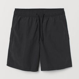 Swim shorts in woven fabric with an elasticized drawstring waistband, side pockets, and back pock... | H&M (US)
