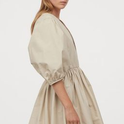 Short, voluminous dress with a deep V-neck that has a concealed hook-and-eye fastener. 3/4-length... | H&M (UK, IE, MY, IN, SG, PH, TW, HK)