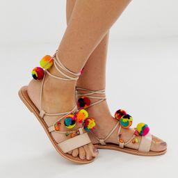 ASOS DESIGN Fun Fair pom pom leather tie leg flat sandals-Beige | ASOS (Global)