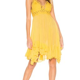 Free People Adella Slip Dress in Yellow. - size M (also in XS,S) | Revolve Clothing (Global)