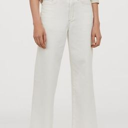 5-pocket, ankle-length jeans in washed, stretch denim with a high waist and straight, wide legs. ...   H&M (UK, IE, MY, IN, SG, PH, TW, HK, KR)