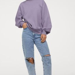 Oversized top in sweatshirt fabric made from a cotton blend with a round neckline, dropped should... | H&M (UK, IE, MY, IN, SG, PH, TW, HK)