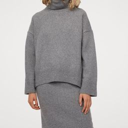 Calf-length skirt in soft, knit fabric with wool content. High waist and covered, elasticized wai... | H&M (US)