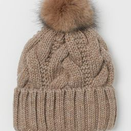 Cable-knit hat in a soft wool blend. Faux fur pompom at top and sewn, foldover cuff.   H&M (US)