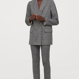 Straight-cut, double-breasted jacket in woven fabric. Notched lapels, buttons at front, and welt ... | H&M (US)