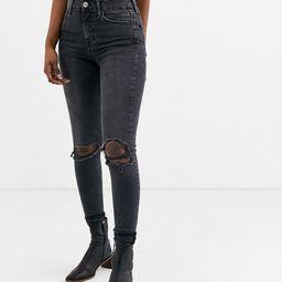 Topshop Jamie skinny jeans with rip knees in black | ASOS (Global)