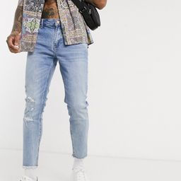 ASOS DESIGN cropped skinny jeans in light wash with raw hem and busted knee-Blue   ASOS (Global)