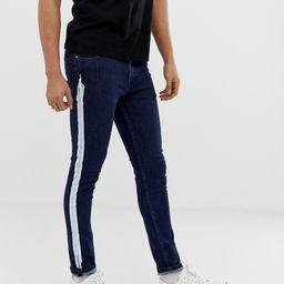 ASOS DESIGN super skinny jeans with white stripe in indigo-Blue | ASOS (Global)