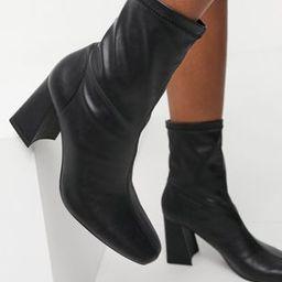 Bershka patent boot with flared heel in black | ASOS (Global)