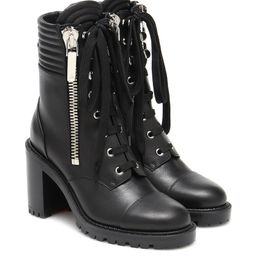 En Hiver 70 leather ankle boots   Mytheresa (US)