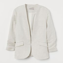 Gently fitted jacket in a soft, woven linen and viscose blend. Concealed hook-and-eye fastener, w... | H&M (US)