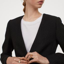 Fitted jacket in woven, textured bouclé with wool content. V-neck and one metal button at front.... | H&M (US)