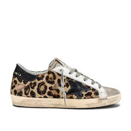 Golden Goose Superstar Sneaker in Snow Leopard & Black Star from Revolve.com | Revolve Clothing (Global)