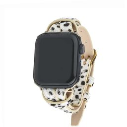 White Spotted Animal Print Apple Watch Strap on Gold | Victoria Emerson