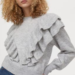 Knitted flounce-detail jumper  £24.99 | H&M (UK, IE, MY, IN, SG, PH, TW, HK)