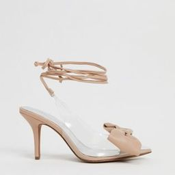 ASOS DESIGN Sylvie tie leg mid-heels with bow in beige and clear | ASOS (Global)