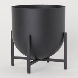 Metal plant pot with a rounded base on a metal pedestal. Pot diameter 8 3/4 in., height 8 1/2 in....   H&M (US)