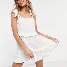 ASOS DESIGN textured ruffle swing mini sundress with tie straps in white | ASOS (Global)