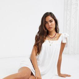Esmee Exclusive swing mini beach dress with tie detail in white | ASOS (Global)