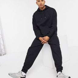 ASOS DESIGN organic tracksuit with oversized hoodie & oversized joggers in black | ASOS (Global)