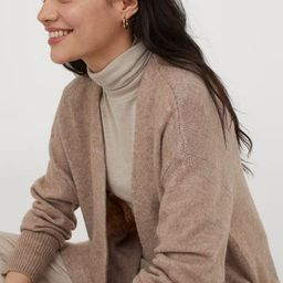 Long cardigan in soft, knit fabric with wool content. Dropped shoulders, patch front pockets, and...   H&M (US)