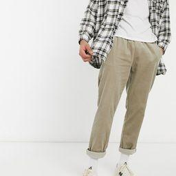ASOS DESIGN cord slim trousers with elasticated waist in dark beige | ASOS (Global)