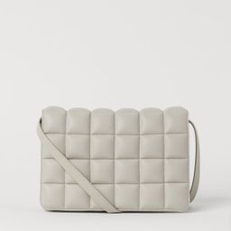 Bag with a narrow, adjustable shoulder strap, a flap and a zipped inner compartment. Lined. Lengt... | H&M (UK, IE, MY, IN, SG, PH, TW, HK, KR)