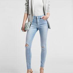 Mid Rise Ripped Raw Hem Skinny Jeans | Express