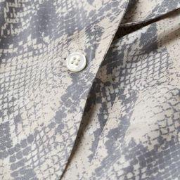 Voluminous shirt in softly draped, woven viscose fabric with a slight sheen. Resort collar, V-nec... | H&M (US)
