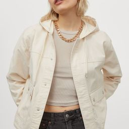 Short jacket in soft cotton twill with a drawstring hood. Concealed snap fasteners at front and f...   H&M (US)