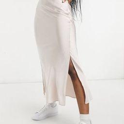 ASOS DESIGN satin bias slip midi skirt with silts in soft pink   ASOS (Global)