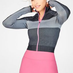 Our fitted, two-tone jacket has a cropped length and mock-neck collar. Add a contrast zipper, and...   Fabletics