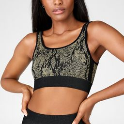 Our low-impact bra is a real snake charmer—and not just because of its allover snake print! Thi...   Fabletics