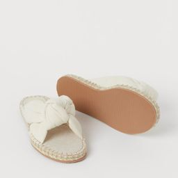 Sandals with two twill straps that are knotted together over the foot, and a braided jute trim ar...   H&M (UK, IE, MY, IN, SG, PH, TW, HK, KR)