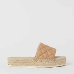 Mules with open toes and a padded, quilted foot strap in imitation leather. Soles with a braided ...   H&M (UK, IE, MY, IN, SG, PH, TW, HK, KR)
