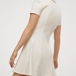 Short dress in ribbed jersey with shaping seams front and back. Collar, wrapover V-neck, and shor... | H&M (US)