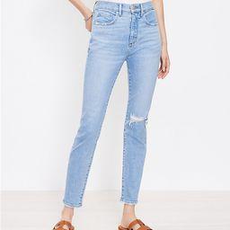 Petite Destructed High Rise Skinny Ankle Jeans in Vivid Light Indigo Wash | LOFT