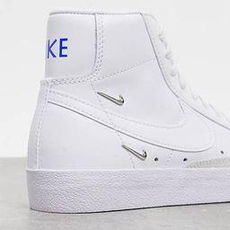 Nike Blazer Mid 77 trainers with metallic mini swoosh in white | ASOS (Global)